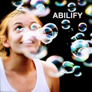 Be Involved_Video History Trainings_Abilify_photo of a young woman gazing skyward through a shower of bubbles