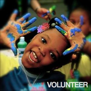 Be Involved_Volunteer_African American toddler with finger paint on her hands