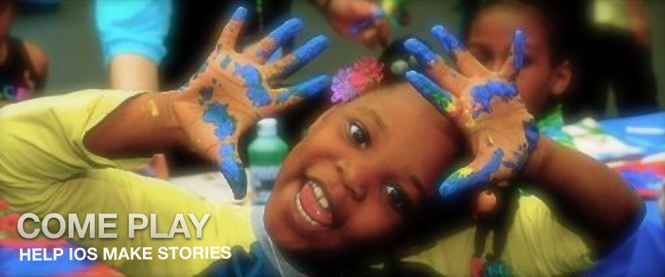 Be Involved_Volunteer_Photo of African American toddler with finger paint on her waving hands