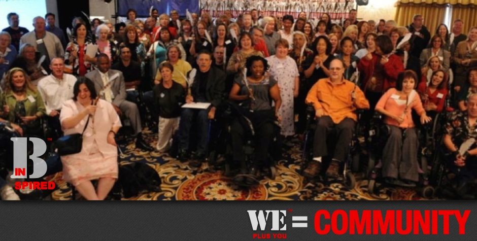 Be Inspired_Story Flag Exhibit_We Plus You Equals Community_photo of 200 disability advocates in front of Story Flag exhibit